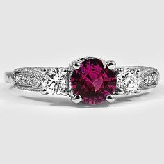Platinum Three Stone Heirloom Diamond Ring // Set with a 6.0mm Pink Round Sapphire #BrilliantEarth