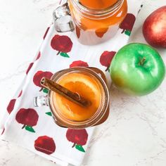 This tasty instant pot apple cider is so easy to make in your pressure cooker! Homemade apple cider is made with green and red apples, an orange, cinnamon sticks, and nutmeg.