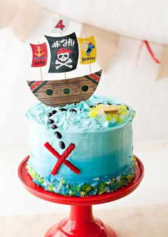 Pirate Party Homemade Cake ~ ombre frosting layer cake, paper toppers | via HWTM