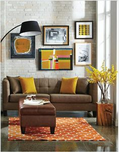 Yellow and orange pops of colour, art and couch