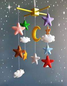 Colorful baby crib mobile nursery stars clouds Moon Boy girl decor Sizes: -Wooden mobile hanger inches cm) -star 3 x 3 inches cm) -moon cm) -small cloud x inches x cm) -big cloud x inches x cm) Thank you for visiting my store. Star Mobile, Boy Mobile, Baby Crib Mobile, Baby Cribs, Cloud Mobile, Felt Crafts, Diy And Crafts, Crafts For Kids, Girl Decor