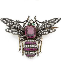 A late 19th century spinel, ruby, emerald and diamond bee brooch Designed as a bee with rose-cut diamond outstreched wings, the thorax set with a large cushion-shaped spinel, the striped abdomen with circular-cut ruby and rose-cut diamond lines, the rose-cut diamond head accented by a step-cut emerald, brooch pin with maker's mark and French assay mark, width 6.1cm