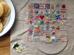 1 inch embroidery squares. I like the idea from amy where each square is something we are grateful for.