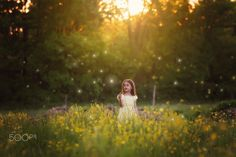 Fireflies - A dream like photo of a little girl discovering fireflies. She stands in a field of tiny yellow flowers wearing a yellow dress. Thank you for visiting. :-) Mary Ann Wamboldt