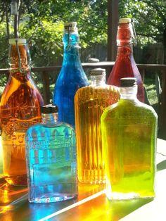 Vintage bottles of colored water.