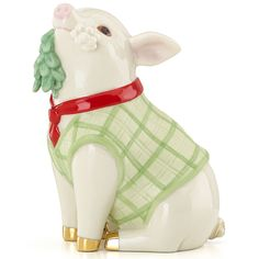 """Meet Me Under the Mistletoe Pig Figurine by Lenox  This sweet piggy is just waiting for his holiday kiss. Dressed in a festive green suit, complete with red tie, he holds a sprig of mistletoe in his mouth, hoping for just the right opportunity. Crafted of ivory china, hand-painted, and accented in gleaming gold, this little fellow is festive and fun, making him a wonderful gift. Crafted of ivory china Hand painted Accented in gold Height: 4"""""""