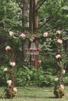 Woodland wonderland flower arch in the middle of a forest @myweddingdotcom
