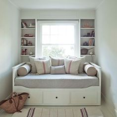 Ikea Hemnes Day bed - The bolster pillows and structured bedding give this non-descript daybed some modern style. Use lime/orange cushions