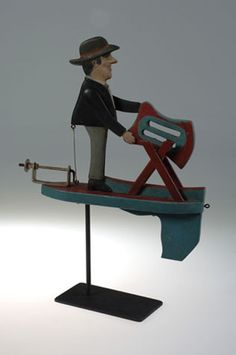 Whirlygig of a man sawing wood...we found one of these at new house. It's adorable folk art.