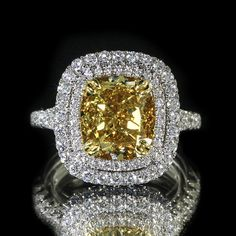 Intense yellow cushion double halo diamond engagement with brilliant round accent set in white gold Pandora Jewelry, Jewelry Rings, Jewelry Accessories, Jewelry Design, Jewellery Box, Halo Diamond Engagement Ring, Modern Jewelry, Or Rose, Bracelets