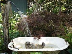 Splish Splash I was taking a bath! What a cute idea for a fountain .