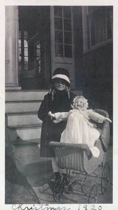 1920s This could be my mother. I played with her carriage and doll (just like these) when I was a child.