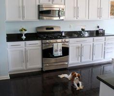 Black floor in white kitchen
