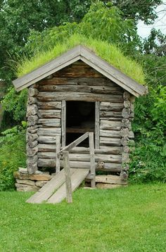 Historic Log Cabin with a sod roof
