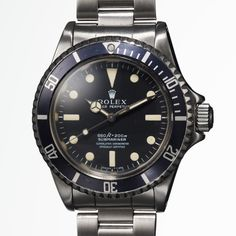 It's not the first McQueen-owned timepiece to come up for auction, but it might be the best. This reference 5513 Rolex Submariner dates to 1964 and was gifted to McQueen's longtime friend and stuntman Loren Janes by McQueen. The watch. Steve Mcqueen Rolex, Steve Mcqueen Style, Fine Watches, Sport Watches, Watches For Men, Wrist Watches, Rolex Submariner 5513, Rolex Submariner No Date, Vintage Rolex