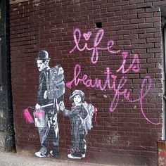 #NYC #Street #Art: Chaplin and children are innocence personified.