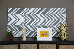Arm yourself with blue tape and a paint brush! Design your own chevron canvas print.