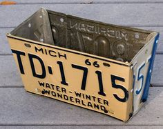 use old license plates to hold plants