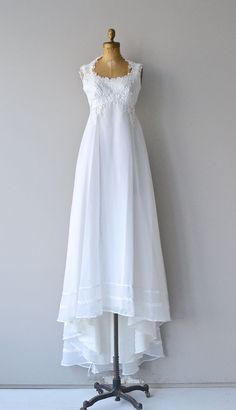 Vintage late 1960s, early 1970s white wedding gown with cotton floral applique, round neckline, empire waist and romantic layered skirt.  --- M E A S