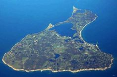 Block Island, RI.  What a fun place.  By boat, by ferry, by plane....however you get there just get there,  it will be worth it.  So much to see.  Great beaches and cliffs.