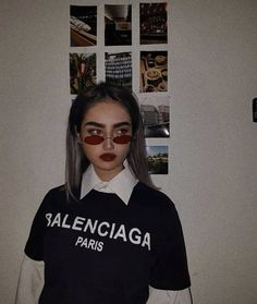 0a2bd082921 Balenciaga black tshirt with a white blouse underneath. The whole outfit  paired with little red glasses