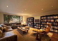 warm lighting // tv room // book shelf wall