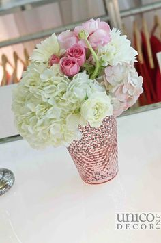 White and pink centrepiece in pink mercury glass vase