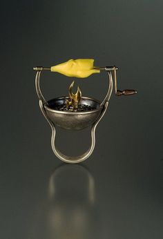 I don't actually want this... but it is unique...Chicken On A Spit Ring by Cooperman Jewelry