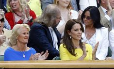 Kate, the Duchess of Cambridge, front right, sits in the Royal Box in front of Bee Gees si...