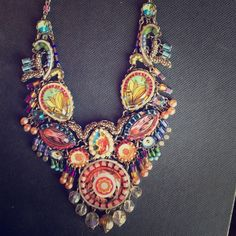 AYALA BAR NECKLACE It is a Ayala Bar necklace which is designed by an Israel designer. I've worn this piece maybe twice. It is like brand new. It includes lots of bead work, fabric and glass pieces. handcrafted. It was from 2 spring seasons ago! You'll never see this line again. Ayala Bar Jewelry Necklaces