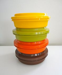 My mom had these! not sure if she still has them,  but each of us had a color. I had a red one. I took it everywhere!!  Vintage Tupperware Stackable Bowls with Lids Retro 70s by KimBuilt, $25.00