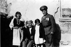 While on leave from the Marines in 1942, Miguel H. Trujillo, far right, poses with his mother-in-law Mary S. Paisano, Pedro Sarracino and Trujillo's daughter Josephine. Trujillo, an Isleta Pueblo native living and teaching at Laguna Pueblo, was refused the right to vote in New Mexico in 1948 even though he had just served in the U.S. military during World War II. He sued in federal court and won a precedent-setting judgement that granted Indians the right to vote in New Mexico.