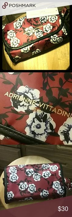 Designer Floral Hanging makeup bag storage case Adrienne Vittadini Floral hanging makeup bag case  Has a gold hook for hanging, many compartments for storing, and a main pouch for bulky storage. The gold zippers accent this lovely bag and contrast against the red & white floral design and the black outline.   Questions? Ask before purchase!! All sales final after shipment is sent.  Bundle to save!!  Price negotiable!! Check out my other items for sale!! Adrienne Vittadini Studio Makeup…