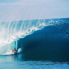Who is deeper in the barrel? The surfer or swimmer?