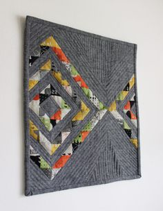 """This mini Reflektion quilt by Vanessa Audette Lynch of Punkin Patterns measures just 12"""" x 14"""". It was made using one mini charm pack of Comma by Zen Chic for Moda Fabrics United Notions , 1/2 yard of Essex by Robert Kaufman Fabrics and Aurifil 50wt thread. To see more, please visit: http://punkinpatterns.com/blog/2016/04/reflektion-mini-quilt.html"""