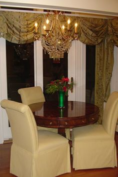Classic silk swag and jabot window treatment in the dining room area.
