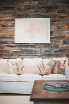 Stikwood accent wall + west elm pillows in a cozy living room