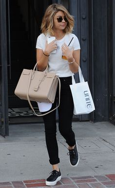 Sarah Hyland in white tee and black jeans