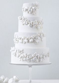 17 unique wedding cake ideas: A single hue makes a huge impact with this all-white bejeweled cake. http://www.colincowieweddings.com/food-and-drink/17-wedding-cakes-that-will-make-you-forget-all-other-cakes