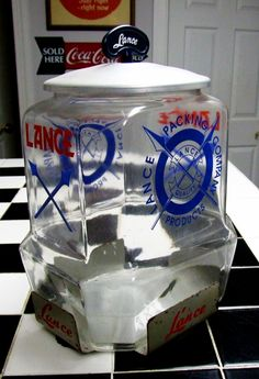 Lance Big Bottom jar with Large Lance Packing Company Logos on sides, Aluminum Lid Bakelite Handle, in single jar holder