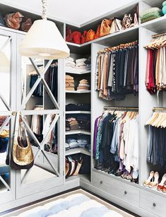 Gorgeous organization in the closet. love the mirrored wardrobe doors and pendant light