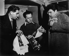 France. Paris. 1950. From left to right: Robert CAPA, Pierre GASSMANN and Ernst HAAS in Gassmann's photographic laboratory. Photo D.R.