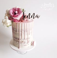Semi naked cake with fresh flowers. By Jenelle's Custom Cakes.
