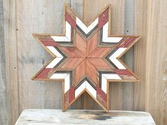 This barn quilt star is the perfect unique, warm and inviting accent to any décor. It is completely hand made one of a kind piece using salvaged and reclaimed woods. This star has salvaged red barn boards boards, greyish blu and white boards saved from an old farmhouse and cedar