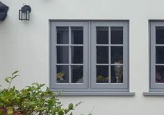 Double glazed uPVC Flush Sash windows from P&P Glass are a high-performance, maintenance-free solution for Surrey and West London homeowners. House With Grey Windows, House Windows, Windows And Doors, Wooden Casement Windows, Upvc Sash Windows, Coloured Upvc Windows, Window Frame Colours, Grey Window Frames, Cottage Front Doors