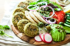 Baked falafel board with coconut yoghurt sauce and dukkah.