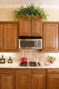 Lighter colored stone counters is often used for smaller kitchen areas. The light color provides some contrast with the warm wood tones and yet reflects light around the kitchen to give it a more open feel, according to the MarbleCity website. This can make a small kitchen look more spacious.
