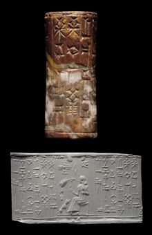 A KASSITE RED AND GREY AGATE CYLINDER SEAL   									CIRCA 1400-1100 B.C.