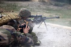 A U.S. Marine sniper with Special- Purpose Marine Air-Ground Task Force Crisis Response, fires a PGM Hécate II, 50. caliber sniper rifle as a French Legionnaire from the 2nd Foreign Infantry Regiment of the 6th Light Armored Brigade spots his rounds Oct. 29, 2013, near Camp des Garrigues, France.