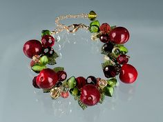 Bing Cherry / Red Cherry Bracelet with handmade glass red cherries. An unforgettable gift for any gardener, gourmet cook, foodie or cherry lover.  $350.  By Elizabeth Johnson.